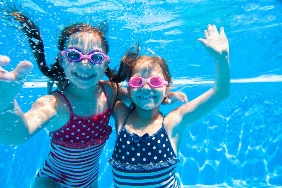 Two young girls in pool